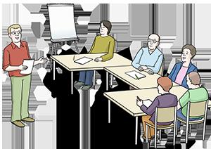 Ein Dozent steht vor einer Gruppe von Seminarteilnehmern