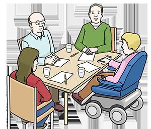Eine Gruppe von Menschen mit und ohne Behinderung tauscht sich aus