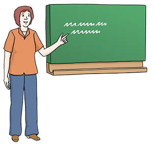 Eine Lehrerin vor einer Tafel